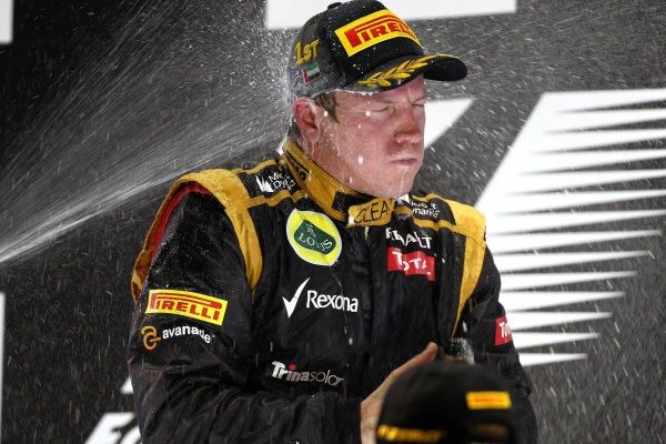 Yas Marina Circuit, Abu Dhabi, United Arab Emirates Sunday 4th November 2012. Kimi Raikkonen, Lotus GP, 1st position, tastes victory. World Copyright:Andy Hone/  ref: Digital Image HONY5909