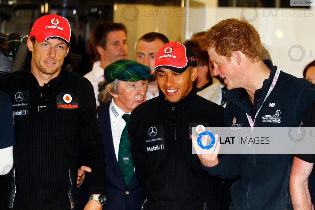 Silverstone, Northamptonshire, England10th July 2011HRH Prince Harry with Jenson Button, McLaren MP4-26 Mercedes, and Lewis Hamilton, McLaren MP4-26 Mercedes. Portrait. VIPs.World Copyright:Charles Coates/LAT Photographicref: Digital Image _W7C4057