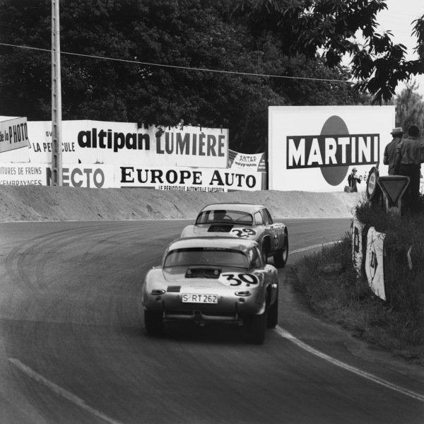 Le Mans, France. 15th - 16th June 1963.Gerhard Koch/Carel Godin de Beaufort (Porsche Carrera 356), retired, leads Heinz Schiller/Ben Pon (Porsche Carrera 356), retired, action. World Copyright: LAT Photographic.Ref:  19305.