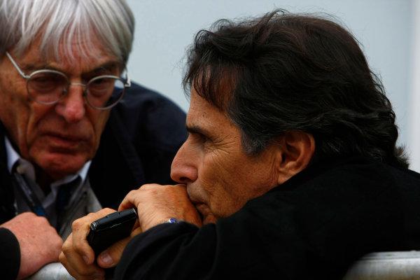 Interlagos, Sao Paulo, Brazil.16th October 2009.Bernie Ecclestone with Nelson Piquet. Portrait. World Copyright: Charles Coates/LAT Photographicref: Digital Image _26Y9433