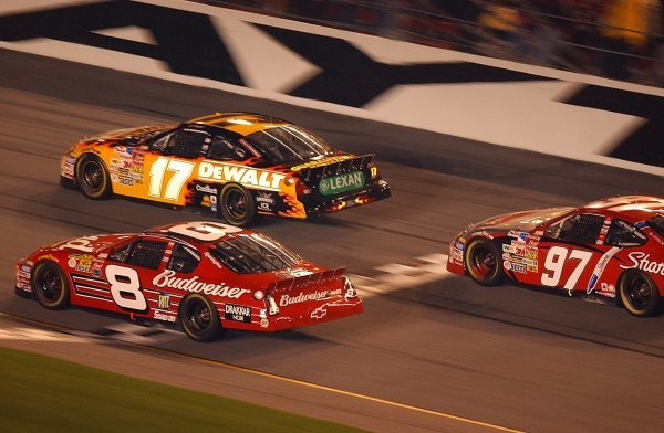 Third placed Matt Kenseth (USA) DeWalt Power Tools Ford leads race winner Dale Earnhardt Jr (USA) Budweiser Chevrolet and eleventh placed Kurt Busch (USA) Rubermaid Ford through the tri-oval. 