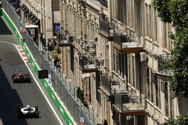 Baku City Circuit, Baku, Azerbaijan. Friday 23 June 2017. Fernando Alonso, McLaren MCL32 Honda, leads Lance Stroll, Williams FW40 Mercedes. World Copyright: Charles Coates/LAT Images ref: Digital Image AX0W5515