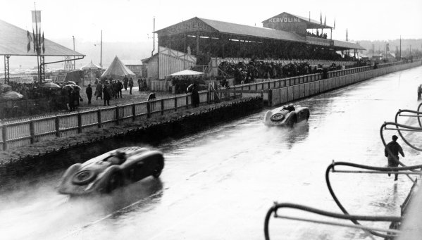 Le Mans, France.19-20 June 1937.Jean-Pierre Wimille/Robert Benoist leads Roger Labric/Pierre Veyron (both Bugatti T57G) past the grandstands. Wimille/Benoist finished in 1st position.Published-Autocar 25/6/1937 p1248.World Copyright - LAT Photographic