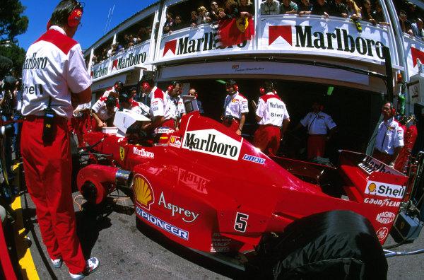 Monte Carlo, Monaco.8-11 May 1997.Michael Schumacher (Ferrari F310B) 1st position in the pit lane.Ref-97 MON 07.World Copyright - LAT Photographic
