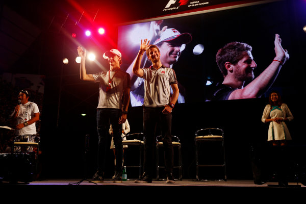 Suzuka Circuit, Japan. Saturday 08 October 2016. Esteban Gutierrez, Haas F1, and Romain Grosjean, Haas F1, at a fan event. World Copyright: Andy Hone/LAT Photographic ref: Digital Image _ONZ4838