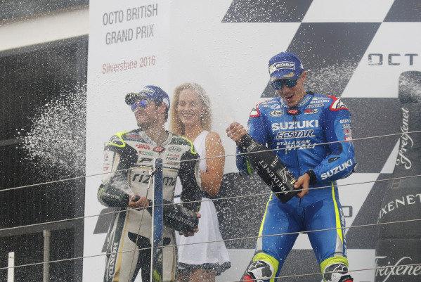 2016 MotoGP Championship.  British Grand Prix.  Silverstone, England. 2nd - 4th September 2016.  Maverick Vinales, Suzuki, celebrates his first MotoGP win on the podium alongside Cal Crutchlow, LCR Honda.  Ref: _W7_9526a. World copyright: Kevin Wood/LAT Photographic