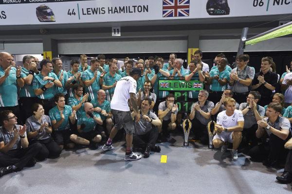 Marina Bay Circuit, Singapore. Sunday 21 September 2014. Lewis Hamilton, Mercedes F1 W05 Hybrid, 1st Position, Nico Rosberg, Mercedes F1 W05 Hybrid, and the Mercedes team celebrate victory. World Copyright: Steve Etherington/LAT Photographic. ref: Digital Image SNE19539
