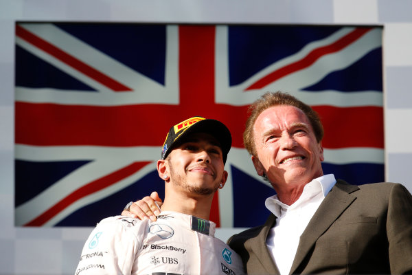 Albert Park, Melbourne, Australia. Sunday 15 March 2015. Actor Arnold Schwarzenegger and Lewis Hamilton, Mercedes AMG, 1st Position, on the podium. World Copyright: Steven Tee/LAT Photographic. ref: Digital Image _F6Q9656