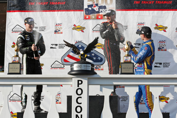 Verizon IndyCar Series ABC Supply 500 Pocono Raceway, Long Pond, PA USA Sunday 20 August 2017 Will Power, Team Penske Chevrolet, Josef Newgarden, Team Penske Chevrolet, Alexander Rossi, Curb Andretti Herta Autosport with Curb-Agajanian Honda celebrate with champagne on the podium World Copyright: Phillip Abbott LAT Images ref: Digital Image abbott_pocono_0817_8089