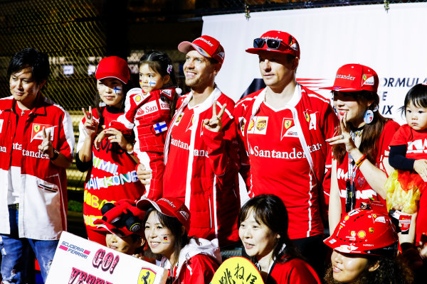 Suzuka Circuit, Japan. Saturday 7 October 2017. Sebastian Vettel, Ferrari, and Kimi Raikkonen, Ferrari, on the stage in the F1 Fanzone. World Copyright: Steven Tee/LAT Images  ref: Digital Image _O3I8799