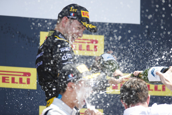 Anthoine Hubert (FRA, BWT ARDEN), celebrates victory by spraying champagne on the podium