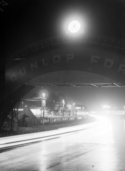 Light trails under the bridge at night.