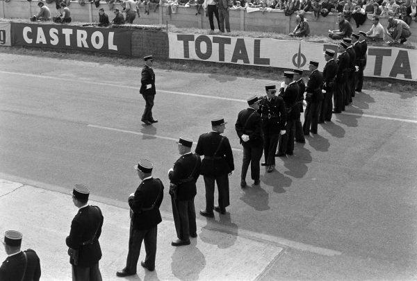 A line of gendarmes across the track.