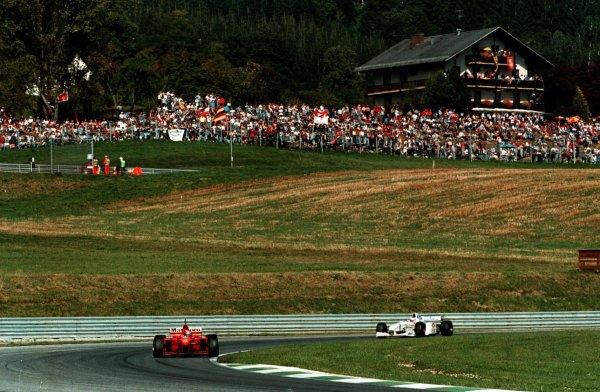 1997 Austrian Grand Prix.A1-Ring, Zeltweg, Austria.19-21 September 1997.Michael Schumacher (Ferrari F310B) 6th position at the Niki Lauda kurve.World Copyright - LAT Photographic