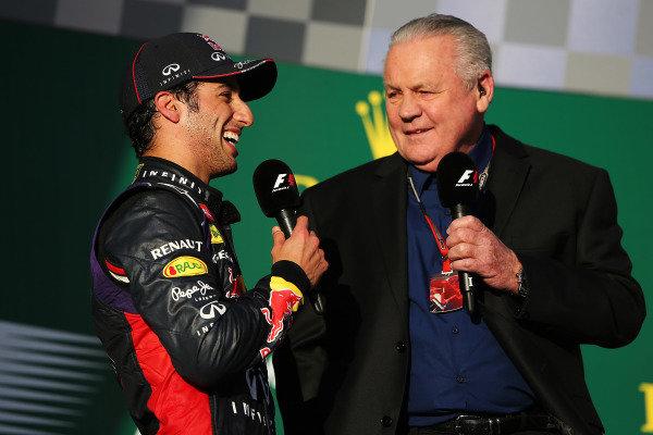 (L to R): Second placed Daniel Ricciardo (AUS) Red Bull Racing is interviewed by former F1 World Champion Alan Jones (AUS) on the podium. Formula One World Championship, Rd1, Australian Grand Prix, Race, Albert Park, Melbourne, Australia, Sunday 16 March 2014.