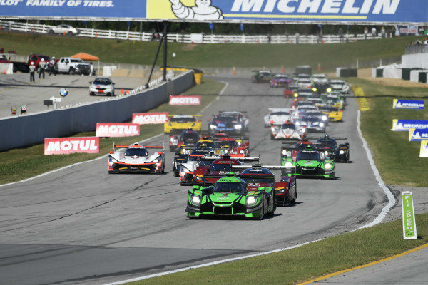 #22 Tequila Patron ESM Nissan DPi, P: Pipo Derani, Johannes van Overbeek, Timo Bernhard lead the field for the start of the race.