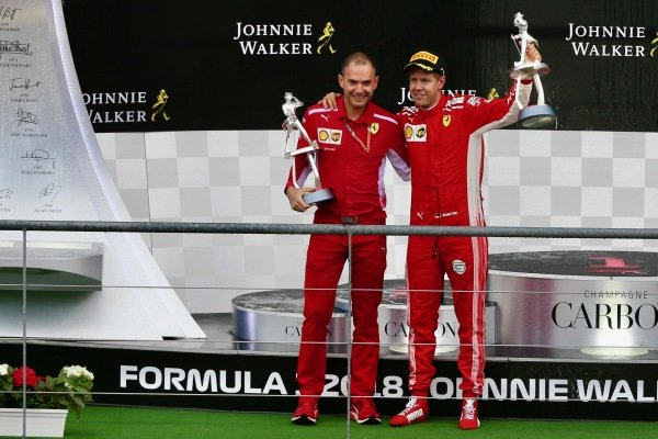 David Sanchez, Ferrari and Sebastian Vettel, Ferrari celebrate on the podium with their trophies