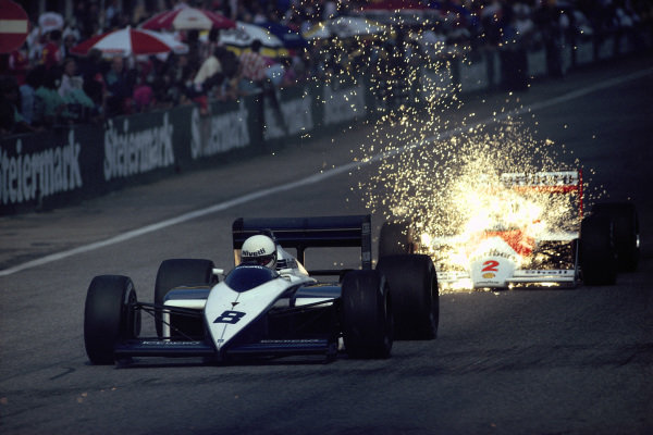 Stefan Johansson, McLaren MP4-3 TAG, is hit by a shower of sparks produced by the titanium skid blocks on Andrea de Cesaris's Brabham BT56 BMW.
