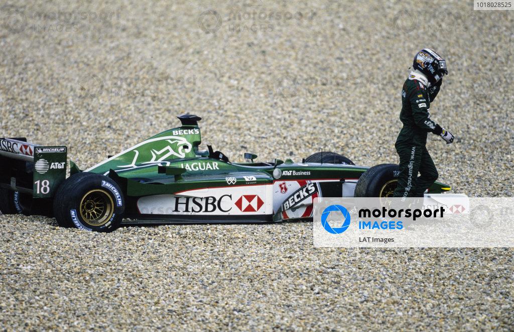 Eddie Irvine walks away from his beached Jaguar R2 Cosworth.