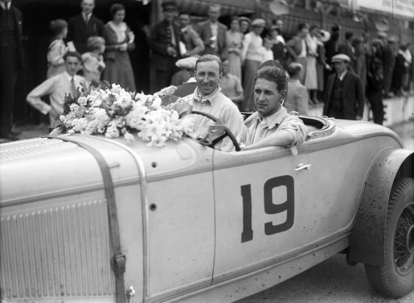 Raymond Sommer and Jean Delemer, 3rd position and 1st in the D+3.0 class, sit in their Chrysler after the race.