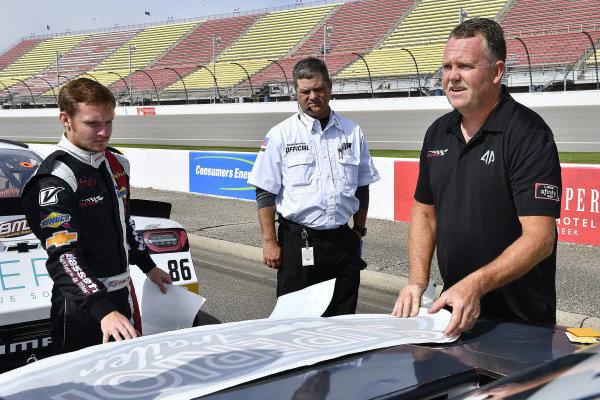 #90: Dillon Bassett, DGM Racing, Chevrolet Camaro DGM Racing installs sponsor decals before qualifying.