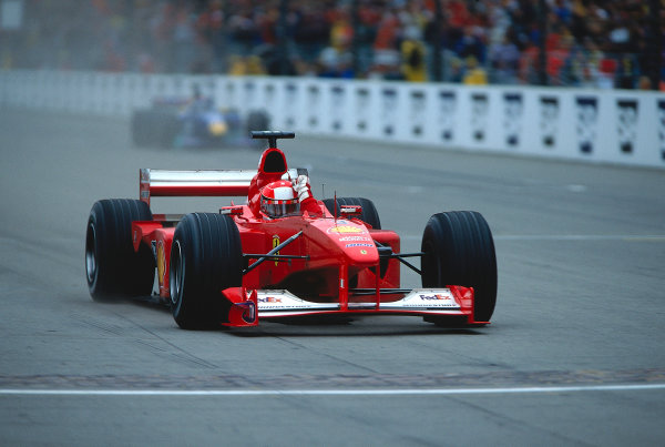 2000 United States Grand Prix.Indianapolis, Indiana, USA. 22-24 September 2000.Michael Schumacher (Ferrari F1-2000) celebrates his 1st position as he crosses the finish line.Ref-2K USA 21.World Copyright - LAT Photographic