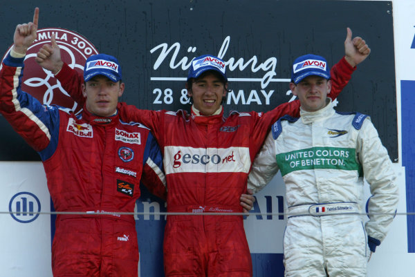 2004 Formula 3000 Championship (F3000) Nurburgring, Germany.29th May 2004. Winner Enrico Toccacelo (BCN F3000) celebrates on the podium with Robert Doornbos (Arden International) and Yannick Schroeder (Durango Formula).World Copyright: LAT Photographic ref: Digital Image Only