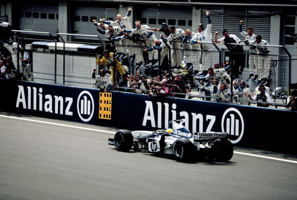 2003 European Grand PrixNurburgring, Germany. 27th - 29th June 2003.Race winner Ralf Schumacher, BMW Williams FW25, crosses the finish line to the cheers of his team.World Copyright: Michael Cooper / LAT Photographic ref: 35mm Image 03Europe05