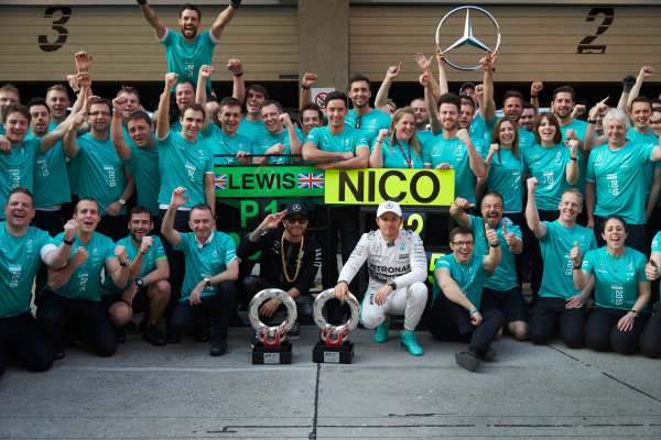 Shanghai International Circuit, Shanghai, China. Sunday 12 April 2015. Lewis Hamilton, Mercedes AMG, 1st Position, and Nico Rosberg, Mercedes AMG, 2nd Position, celebrate another victory with their team mates. World Copyright: Steve Etherington/LAT Photographic. ref: Digital Image SNE20556