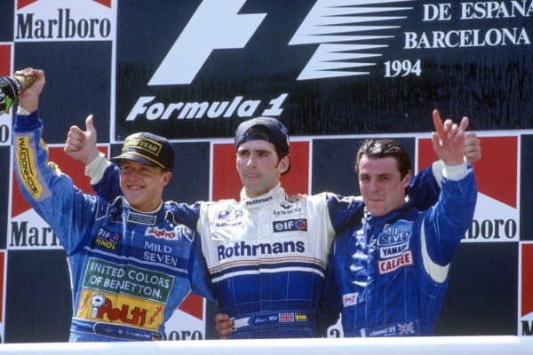 1994 Spanish Grand Prix. Catalunya, Barcelona, Spain. 27th - 29th  May 1994. Damon Hill (Williams FW16 Renault) 1st position salutes the crowd with Michael Schumacher (Benetton B194 Ford) 2nd position and Mark Blundell (Tyrrell Yamaha 022) 3rd position, podium. World Copyright: LAT Photographic. ref: 35mm Colour Transparency.