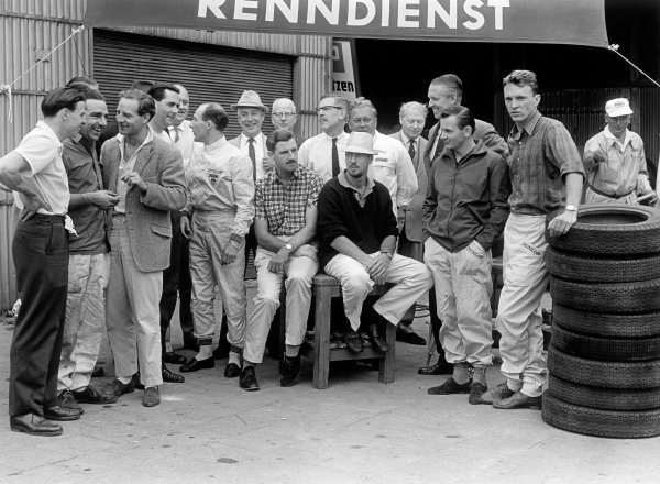 Nurburgring, Germany. 6 August 1961. L -R: Jim Clark, John Cooper, Innes Ireland, Jack Brabham, Stirling Moss, Graham Hill, Jo Bonnier, Bruce McLaren and Dan Gurney, portrait. World Copyright: LAT Photographic Ref: 9334C/4