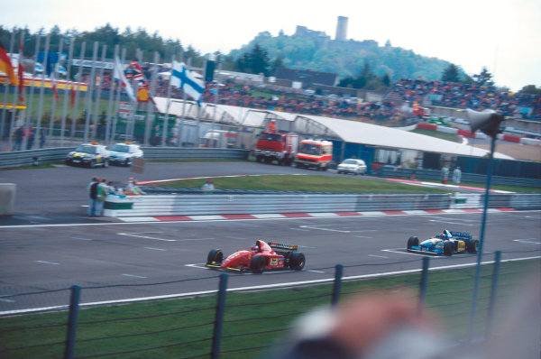 Nurburgring, Germany.29/9-1/10 1995.Jean Alesi (Ferrari 412T2) leads Michael Schumacher (Benetton B195 Renault).Ref-95 EUR 01.World Copyright - LAT Photographic