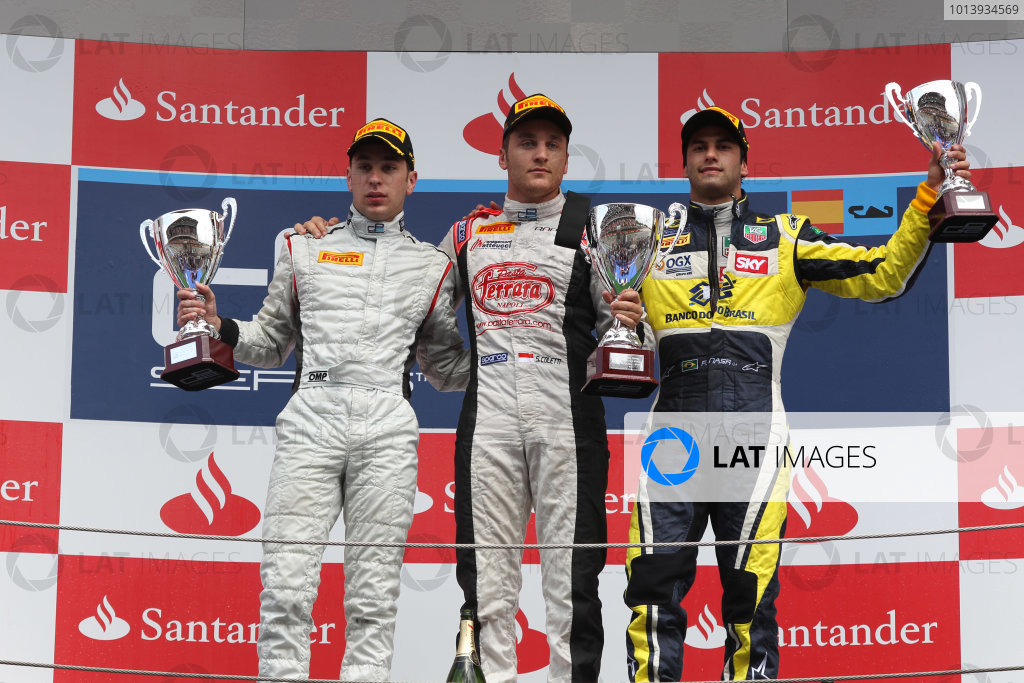 2013 GP2 Series. Round 3.  Circuit de Catalunya, Barcelona Spain. 12th May 2013. Sunday Race. Stefano Coletti (MON, Rapax) celebrates his victory on the podium with Robin Frijns (NED, Hilmer Motorsport) and Felipe Nasr (BRA, Carlin). World Copyright: Malcolm Griffiths/GP2 Series Media Service. Ref: C76D6054