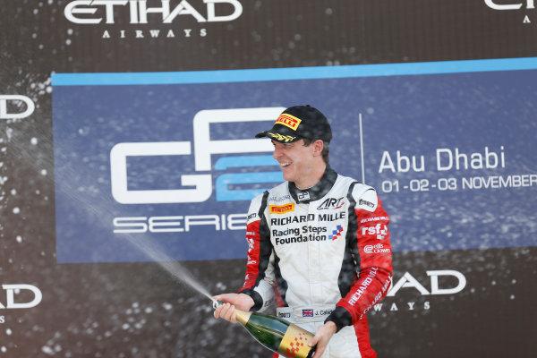 2013 GP2 Championship. Round 11. Yas Marina Circuit, Abu Dhabi, United Arab Emirates. 3rd November 2013. Sunday Race.  James Calado (GBR , ART Grand Prix) celebrates his victory on the podium.  Photo: Alastair Staley/GP2 Media Service.  ref: Digital Image _R6T7744.jpg