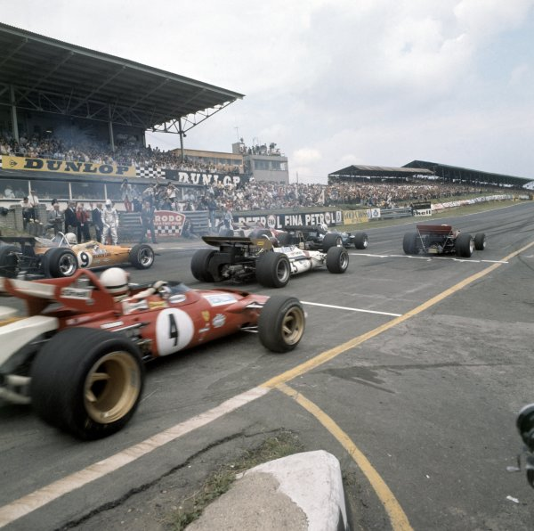 1970 British Grand Prix.Brands Hatch, Great Britain. 18 July 1970.Jochen Rindt, Lotus 72-Ford, 1st position, Jack Brabham, Brabham BT33-Ford, 2nd position, and Jacky Ickx, Ferrari 312B, retired, lead at the start. Jackie Oliver, BRM P153, retired, Denny Hulme, McLaren M14D-Ford, 3rd position, and Clay Regazzoni, Ferrari 312B, 4th position, follow off the grid, action.World Copyright: LAT PhotographicRef: Medium format transparency