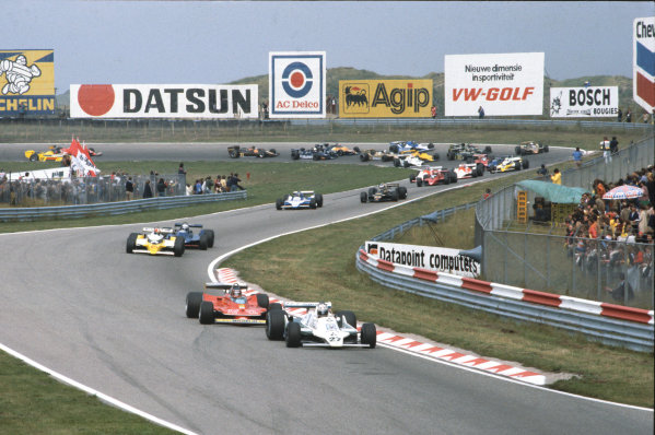 Zandvoort, Holland. 24 - 26 August 1979.Alan Jones (Williams FW07-Ford), 1st position, leads Gilles Villeneuve (Ferrari 312T4), retired, Jean-Pierre Jabouille (Renault RS10), retired,  and Didier Pironi (Tyrrell 009 Ford), retired,  at the start, action. World Copyright: LAT Photographic.Ref:  79HOL02.