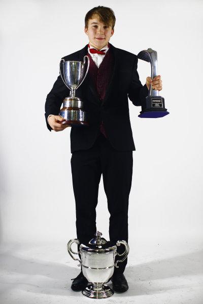 2013 Autosport Awards. Grosvenor House Hotel, Park Lane, London. Sunday 1st December 2013. McLaren Autosport BRDC Award winner Matt Parry poses with his trophies. World Copyright: Malcolm Griffiths/LAT Photographic. ref: Digital Image F80P2158