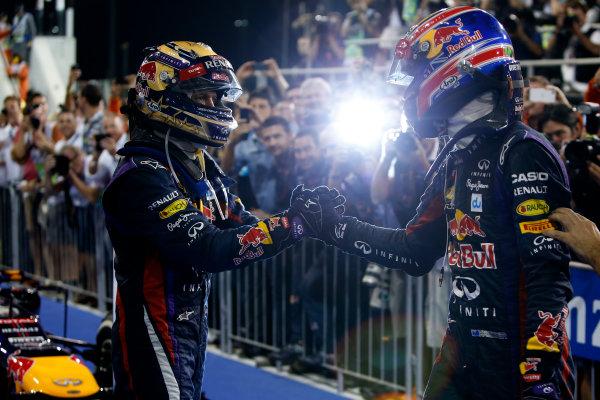 Yas Marina Circuit, Abu Dhabi, United Arab Emirates. Sunday 3rd November 2013. Sebastian Vettel, Red Bull Racing, 1st position, celebrates in Parc Ferme with Mark Webber, Red Bull Racing, 2nd position. World Copyright: Glenn Dunbar/LAT Photographic. ref: Digital Image _89P4262
