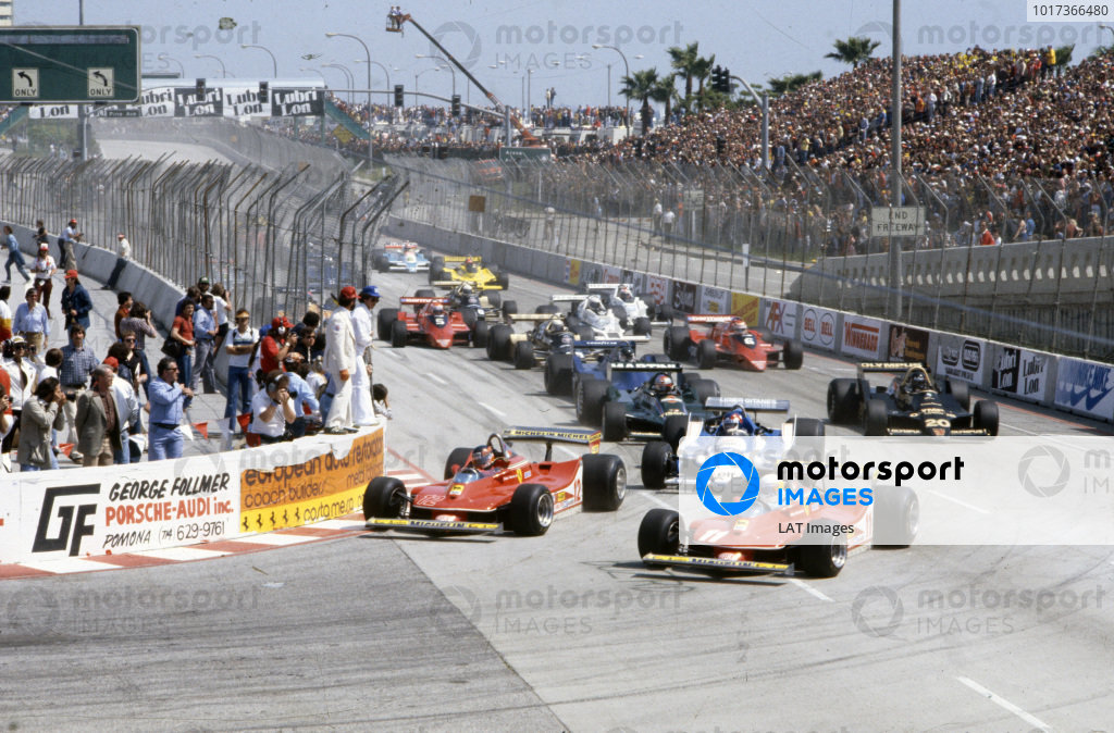 Jody Scheckter, Ferrari 312T4 makes a move on pole sitter Gilles Villeneuve, Ferrari 312T4 at the start ahead of Patrick Depailler, Ligier JS11 Ford and Mario Andretti, Lotus 79 Ford.