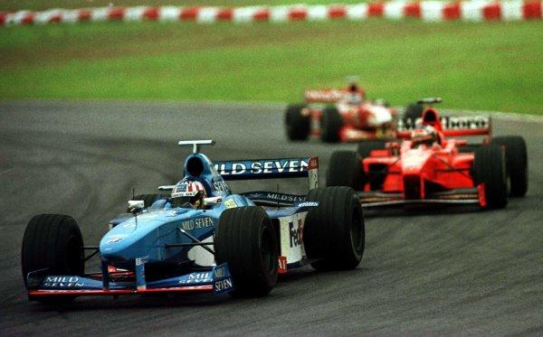 1998 Brazilian Grand Prix.Interlagos, Sao Paulo, Brazil.27-29 March 1998.Alexander Wurz (Benetton B198 Playlife) leads Michael Schumacher (Ferrari F300) and Heinz-Harald Frentzen (Williams FW20 Mecachrome).World Copyright - LAT Photographic