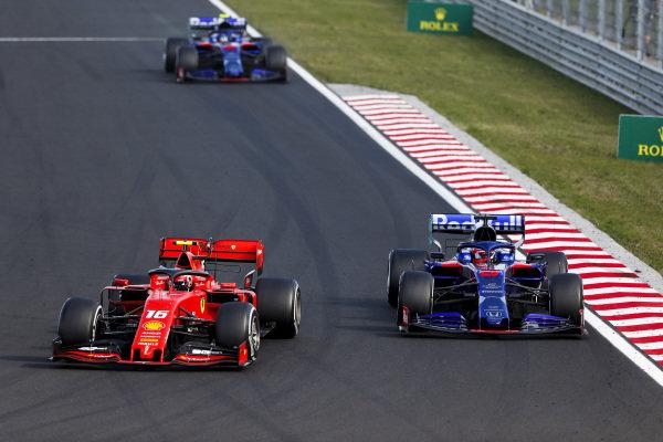 Charles Leclerc, Ferrari SF90, leads Daniil Kvyat, Toro Rosso STR14, and Alexander Albon, Toro Rosso STR14