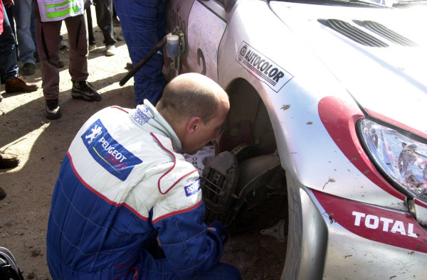 2001 World Rally Championship. ArgentinaMay 3rd-6th, 2001Didier Auriol examines the damage on his Peugeot at the end of stage 20.Photo: Ralph Hardwick/LAT