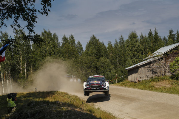 World Champion Sebastien Ogier sideways over a crest on Rally Finland