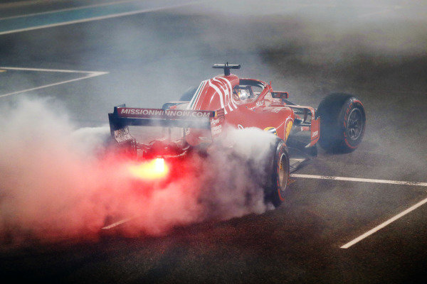 Sebastian Vettel, Ferrari SF71H, performs a doughnut on the grid at the end of the race