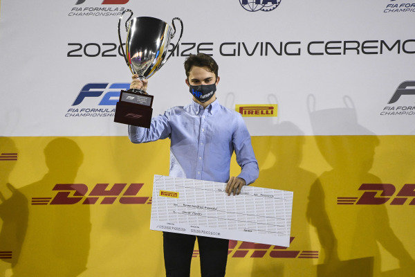 F3 Championship Winner Oscar Piastri (AUS, PREMA RACING) celebrates on the podium with the trophy