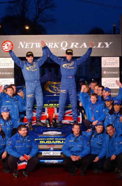 2001 FIA World Rally Championship.Rally of Great Britain. Cardiff, Wales. November 22-25, 2001.Richard Burns and Robert Reid celebrate with the Subaru World Rally Team on the podium.Photo: Ralph Hardwick/LAT