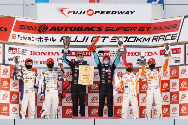 GT500 Winners and 2020 GT500 Drivers' Champions Naoki Yamamoto & Tadasuke Makino ( #100 RAYBRIG Honda NSX-GT ) celebrate on the podium. Either side are Ryo Hirakawa & Kenta Yamashita ( #37 KeePer TOM'S Toyota GR Supra ) 2nd position, and Yuhi Sekiguchi & Sacha Fenestraz ( #36 au TOM'S Toyota GR Supra ) 3rd position