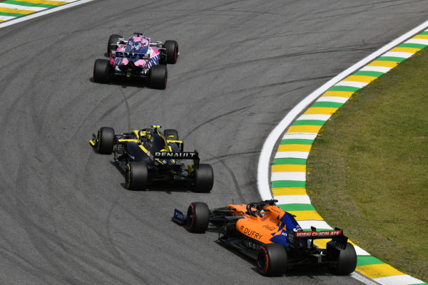 Sergio Perez, Racing Point RP19, leads Nico Hulkenberg, Renault R.S. 19, and Carlos Sainz Jr., McLaren MCL34