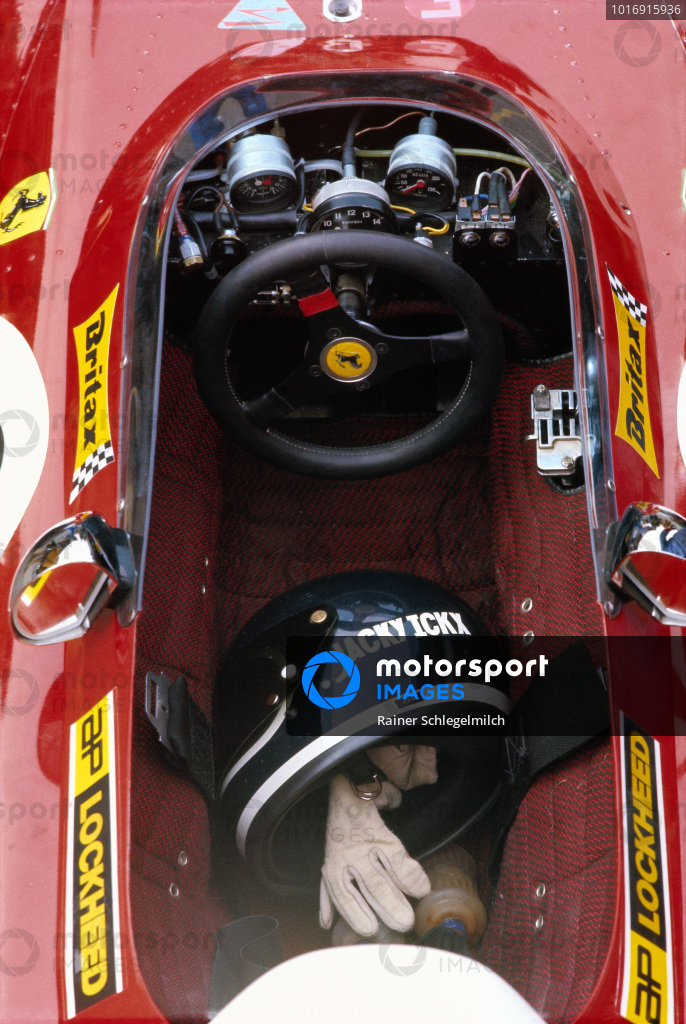 The helmet and gloves of Jacky Ickx in the cockpit of his Ferrari 312B2.