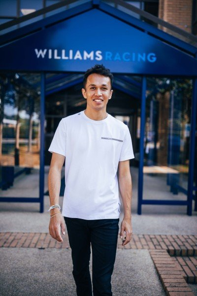 Alex Albon poses outside of the Williams factory in Grove, Wantage, Oxfordshire, after signing to race for the team in 2022. Thomas Marzusch/Williams F1